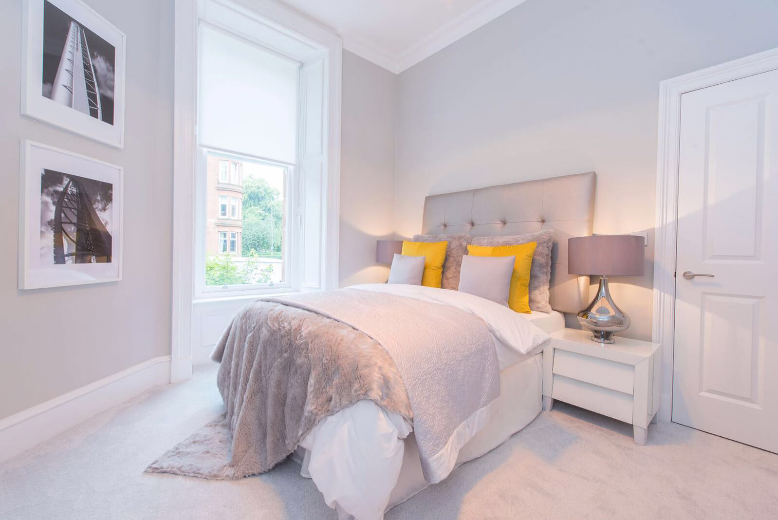 Furnished and carpeted second bedroom with large single window