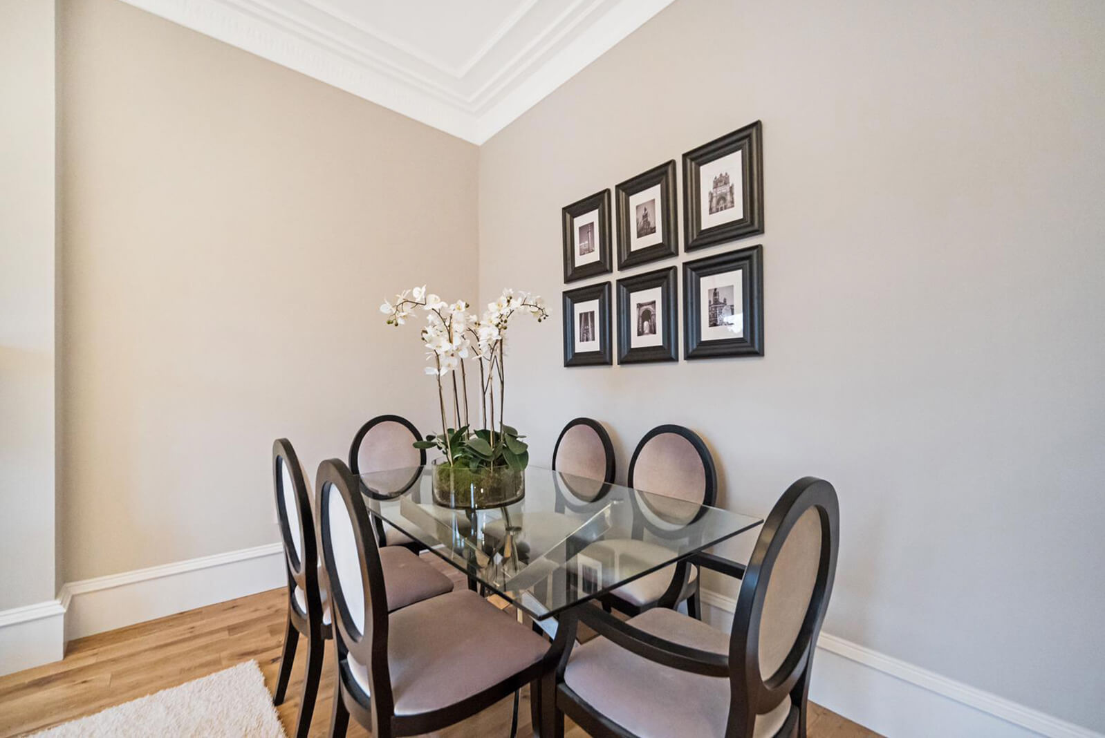 Dining area situated in the corner of the lounge. Large rectangular table with six chairs.